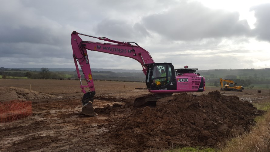 Work Is A Breeze For Pink Jcb On A Wind Farm Job